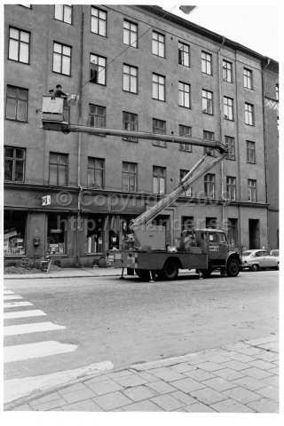 The city administration replaces light bulbs in the street lights with a sky lift, Stockholm. (1970)